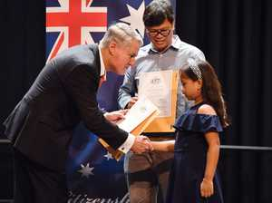 Mayor Greg Williamson presents Jade and Joseph Mateo