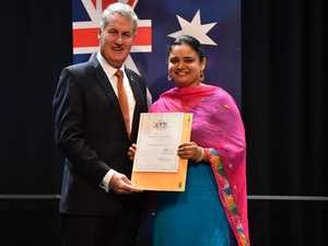 Mayor Greg Williamson presents Sandeep Brar with her
