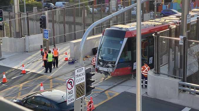 Tram derails in crash with car near SCG