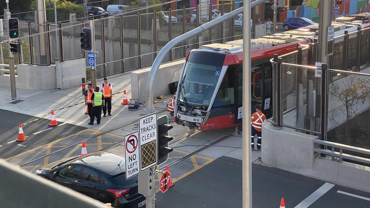 South Dowling St was blocked in both directions between Cleveland and Flinders Sts. Picture: Chris Harris