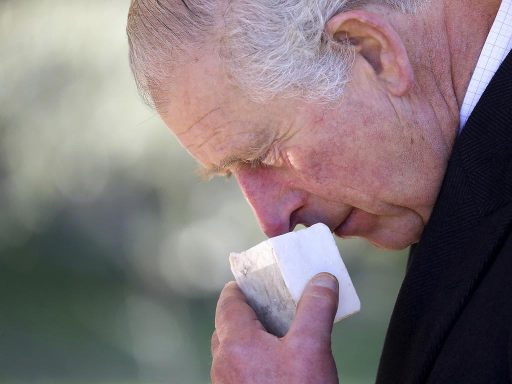 Prince Charles smells olive soap during a visit to Israel. Picture: Chris Jackson