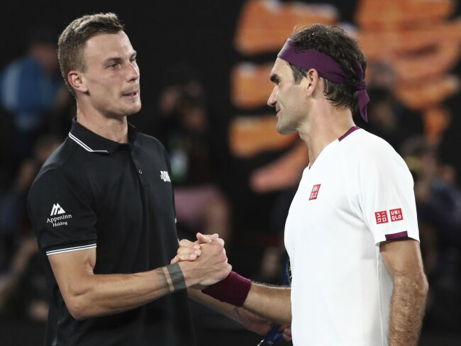 Hungary's Morton Fucsovics congratulates Federer as he crashes out of the Australian Open.