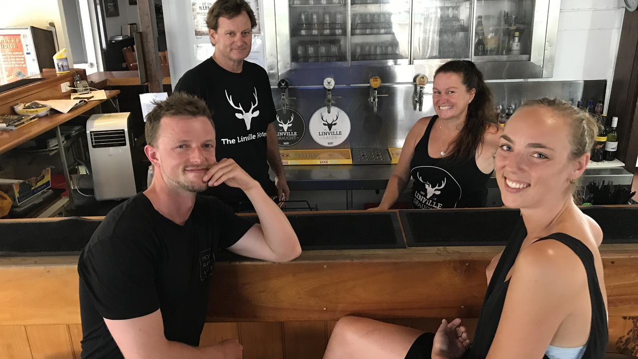 Paul and Leah Squire (behind the bar) serve Isaac Spedding from New Zealand, and Giorgia Stawaruk from Brisbane, at the Linville Hotel. (Picture: Marguerite Cuddihy)