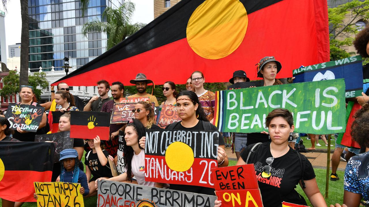 Protestors are seen during the Invasion Day rally in Brisbane. Picture: AAP Image/Darren England