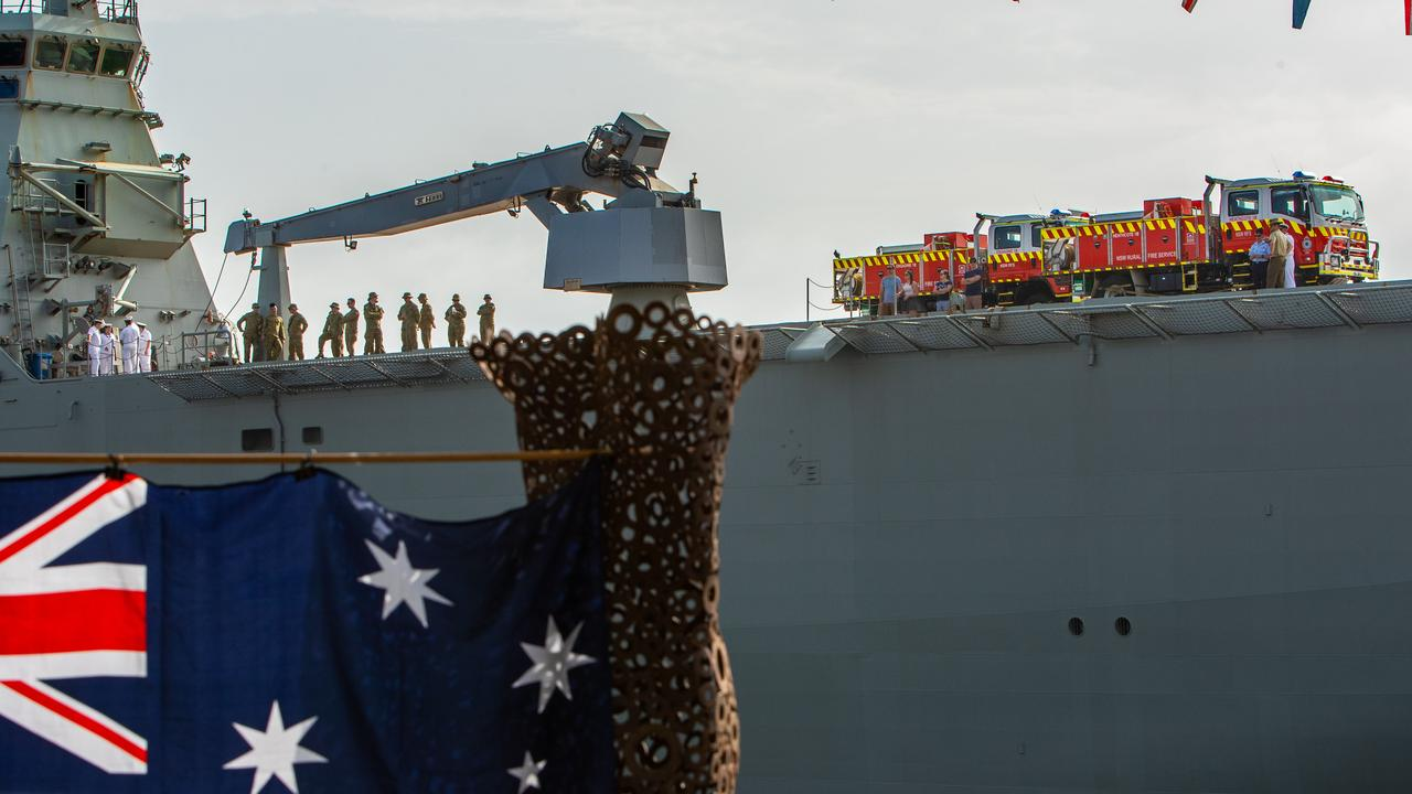 RFS fire-trucks on HMAS Canberra as it docks in Circular Quay. Picture: Julian Andrews