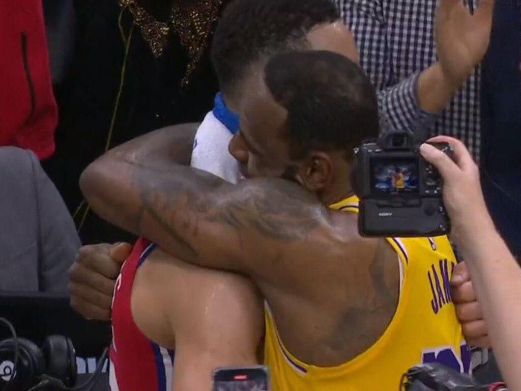 LeBron hugs Ben Simmons after making history.