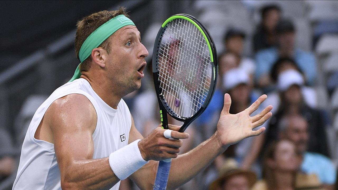 Tennys Sandgren complains to the umpire during his win over Fabio Fognini. Picture: AP/Andy Brownbill