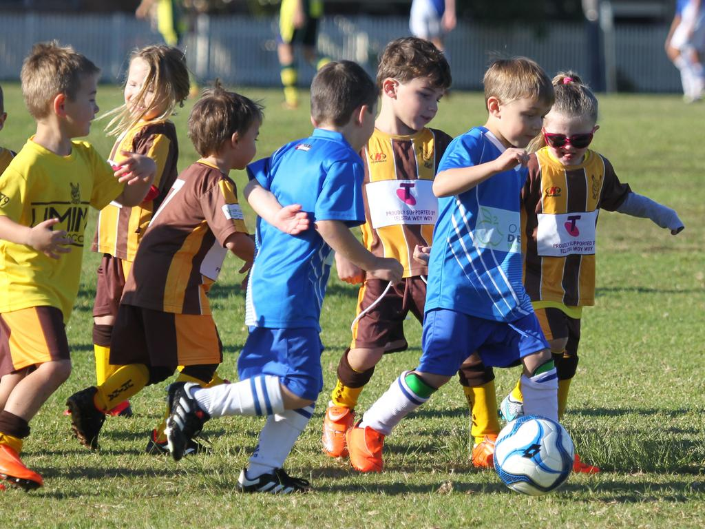 More children should be given the opportunity to play organised sport. Picture: AAP image/ Mark Scott