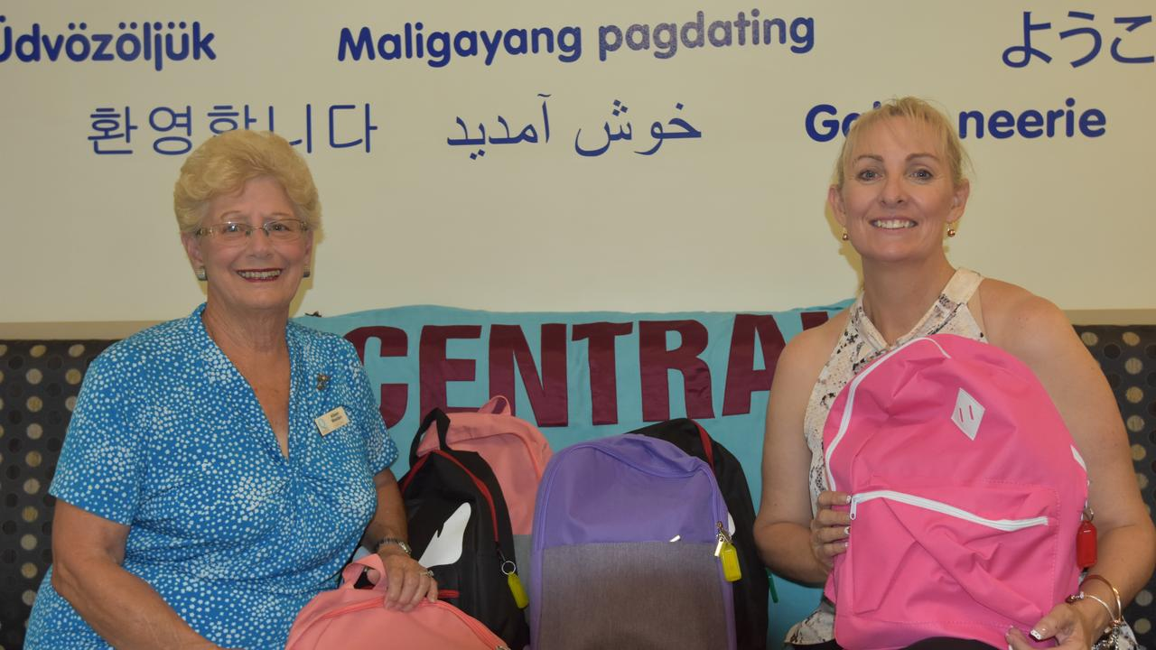 Quota Club of Gladstone secretary Aileen Weeden and Gladstone Central State School Principal Leanne Martin receiving a donation of six school bags.