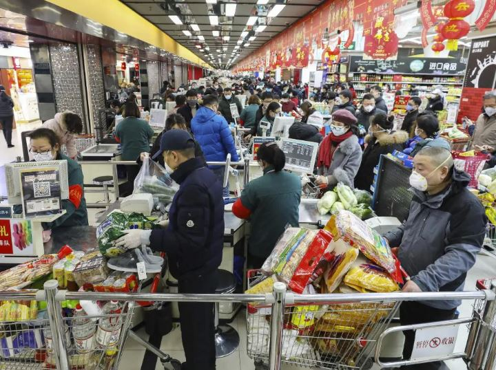 Shoppers wearing face masks at a supermarket in Wuhan. Picture: AP