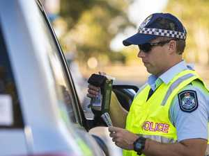 Drunk driver vomits at the wheel when pulled over by police