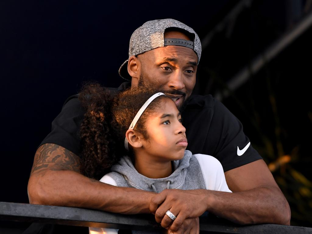 Kobe Bryant and daughter Gianna Bryant watch during day 2 of the Phillips 66 National Swimming Championships at the Woollett Aquatics Center on July 26, 2018 in Irvine, California. Picture: Getty