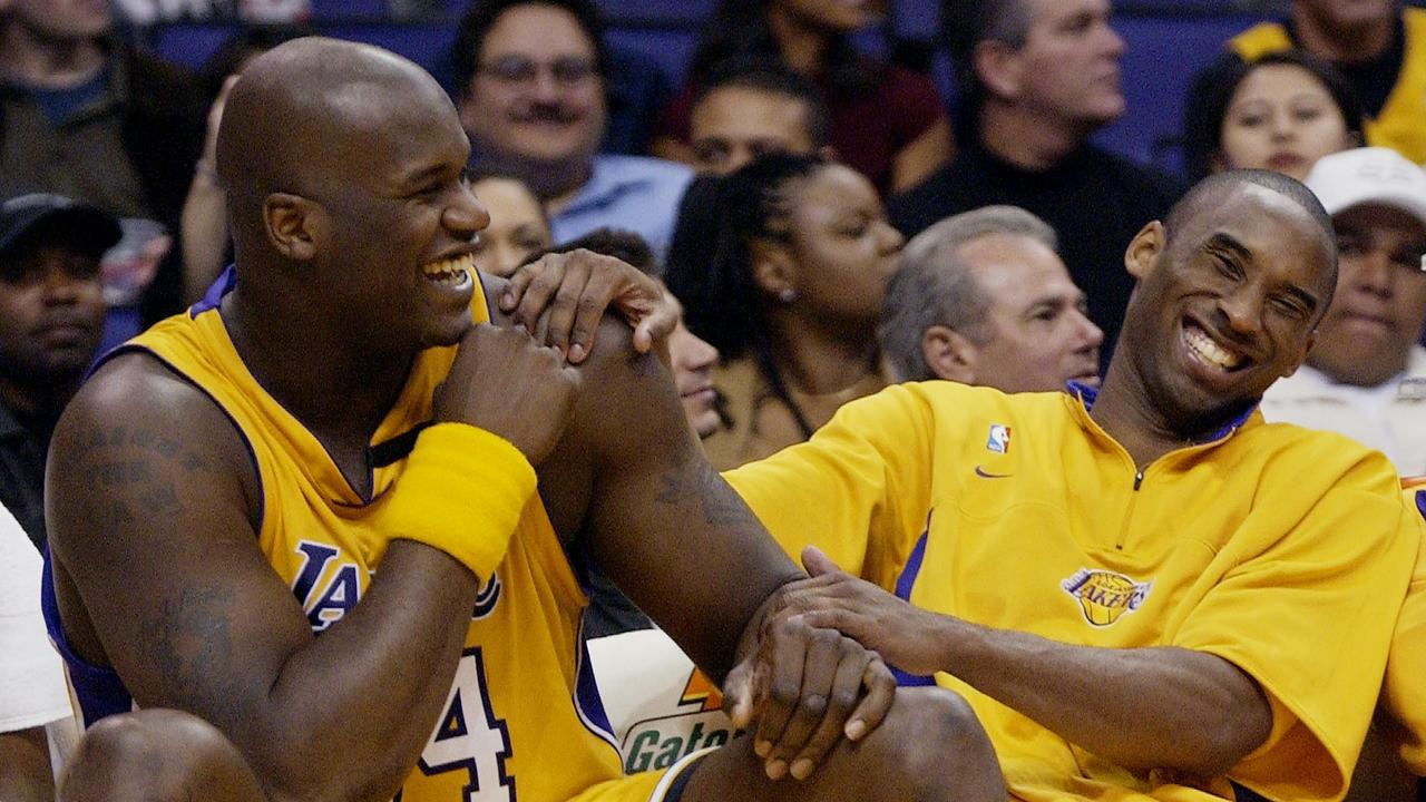 Los Angeles Lakers Shaquille O'Neal shares a laugh with Kobe Bryant on the bench while their teammates take on the Denver Nuggets during the fourth quarter at Staples Center in Los Angeles. Picture: AP