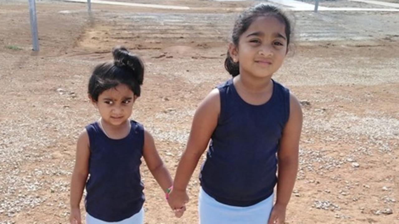 Australian born sisters Kopika (4, right) and Tharunicaa (2) at the detention centre on Christmas Island.