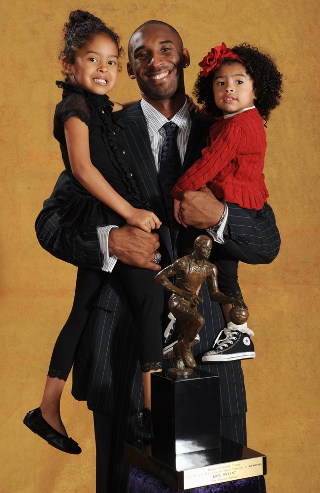 Kobe Bryant #24 of the Los Angeles Lakers poses for a portrait with his daughters Natalia and Gianna at the 2007-08 NBA Most Valuable Player Award press conference presented by Kia Motors at the Sheraton Gateway Hotel on April 29, 2008 in Los Angeles California. Picture: Getty