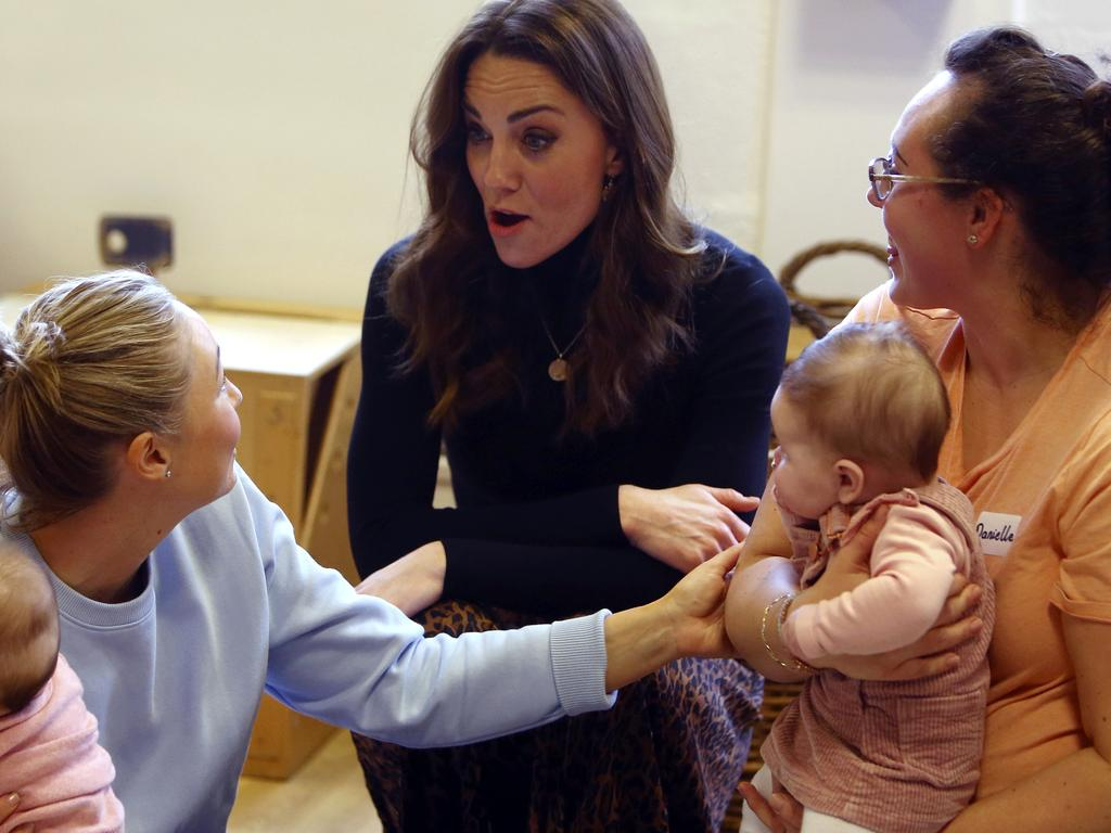 Britain's Kate, Duchess of Cambridge, centre, chats with mothers and babies during her visit to the Ely & Caerau Children's Centre in Cardiff. Picture: Geoff Caddick/PA via AP