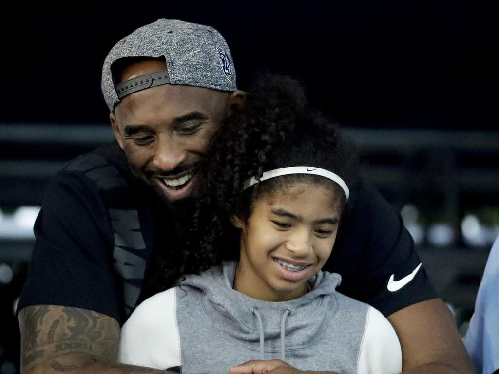 Former Los Angeles Laker Kobe Bryant and his daughter Gianna watch during the U.S. national championships swimming meet. Picture: AP