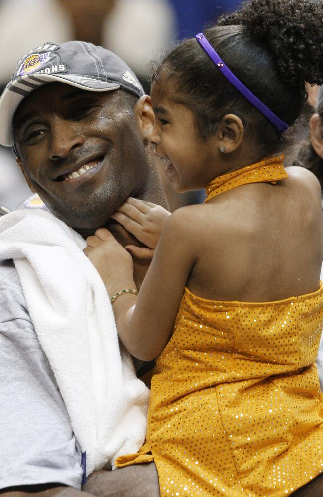 Los Angeles Lakers' Kobe Bryant holds his daughter, Gianna, after defeating the Orlando Magic 99-86 in Game 5 to win the NBA basketball finals in Orlando, Florida in 2009. Picture: AP