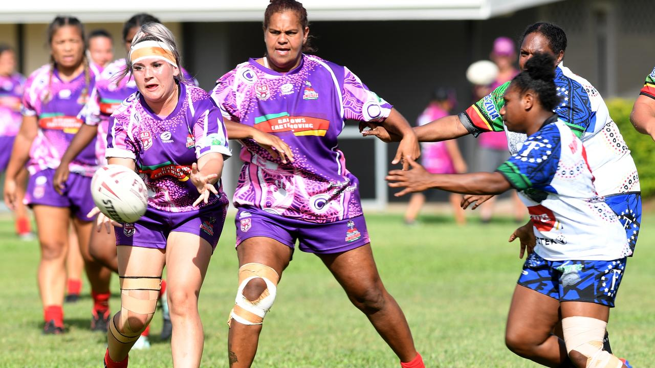 mu Park co-captain Samartha Leisha (centre) comes in to support teammate Patrice Chambers in the women's grand final against the FNQ Stingers at the Warba Wangarunya carnival on Sunday. Photo: Jann Houley
