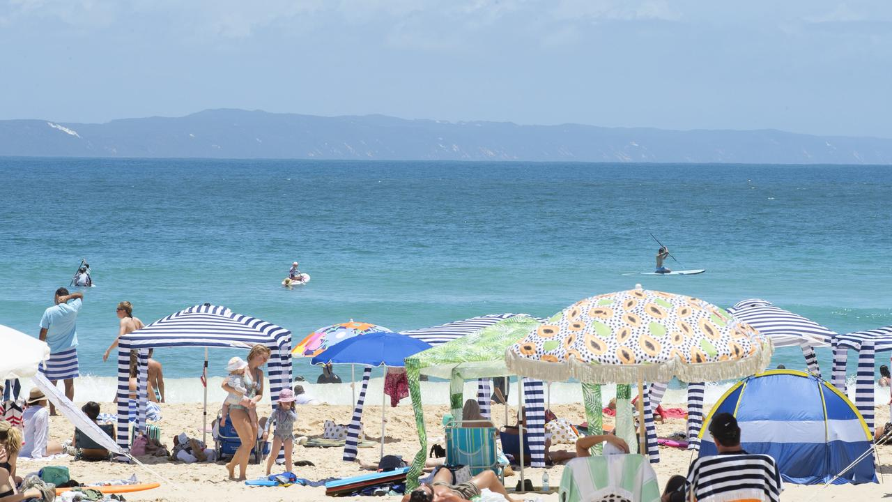 Swimmers have been called from the water and beaches closed on the Sunshine Coast with three shark sightings in two days.