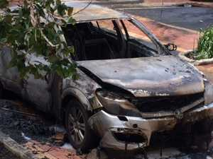 Crews rush to units as car goes up in flames