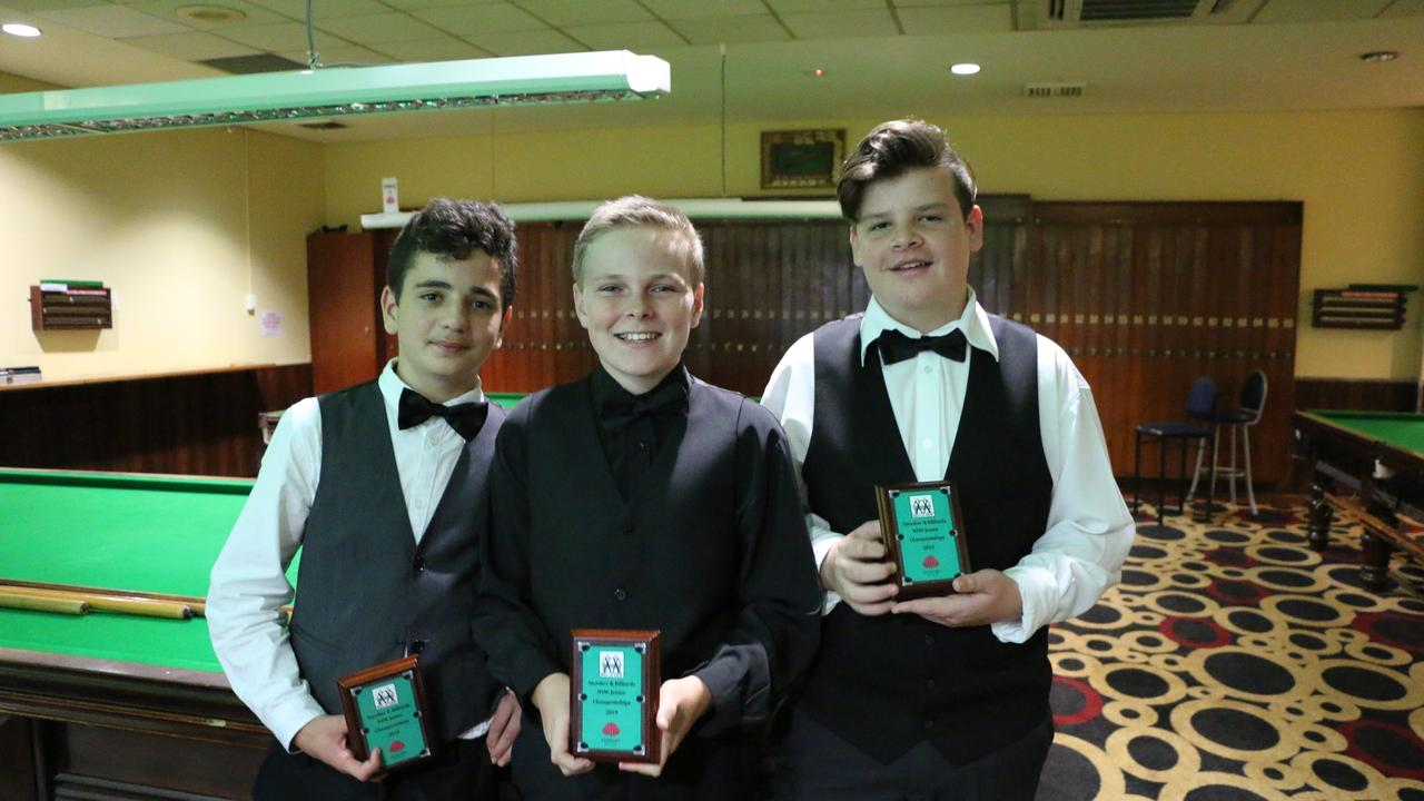 Twin Towns Snooker Club juniors Christiano De Azevedo, Cooper Thomson and Kane Woolway with their NSW Junior Championships trophies.
