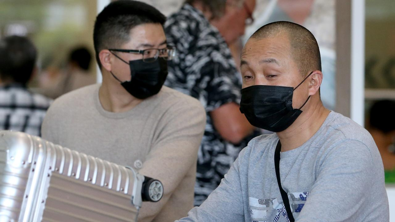 Passengers in masks at Brisbane International airport. Picture: Steve Pohlner