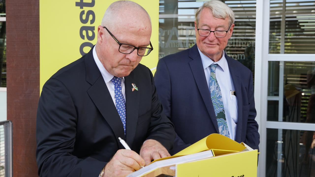 Sunshine Coast Mayor Mark Jamieson presents a copy of the new Sunshine Coast Design book to University of the Sunshine Coast Vice-Chancellor Professor Greg Hill.