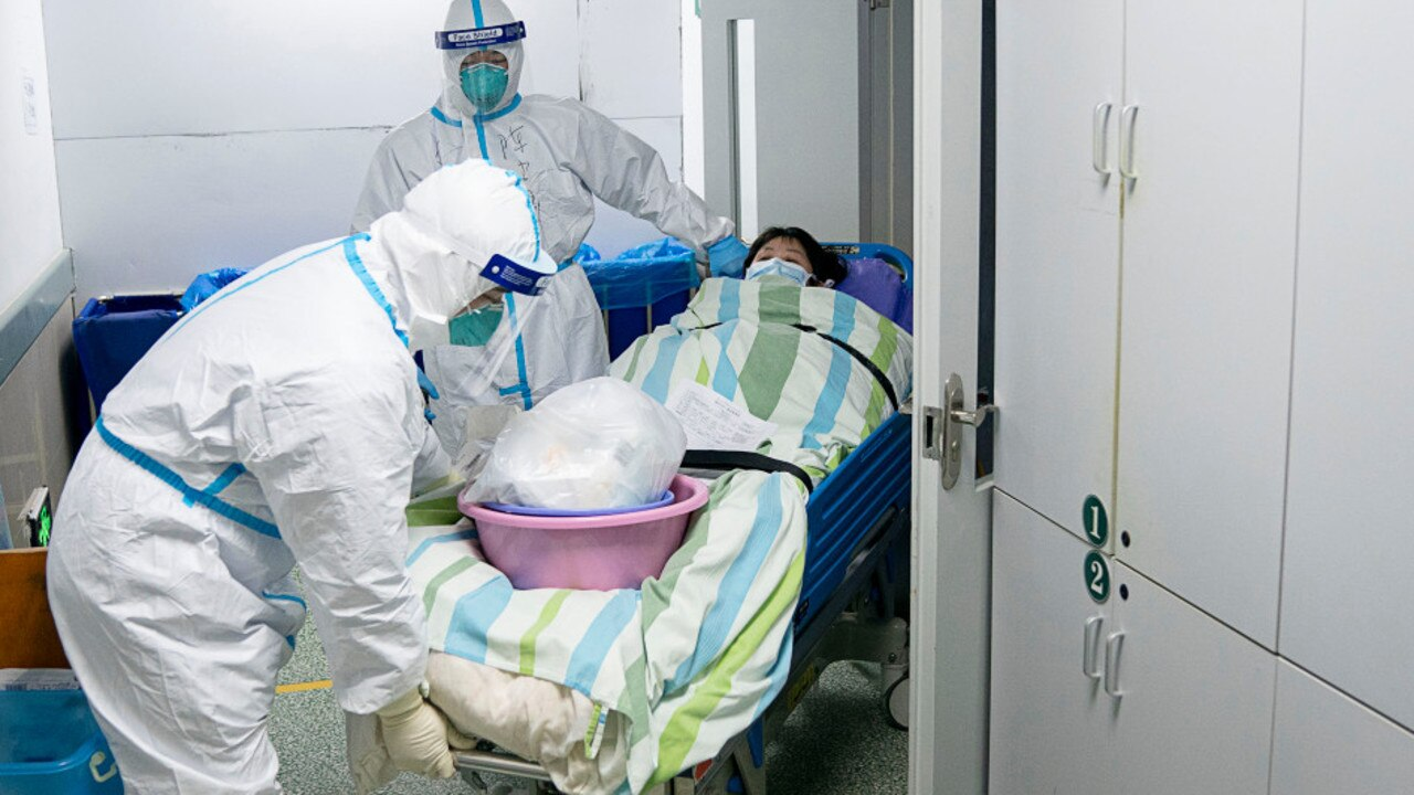 Staff at a Wuhan hospital are wearing adult diapers under their hazmat suits, it has been reported. Picture: AP