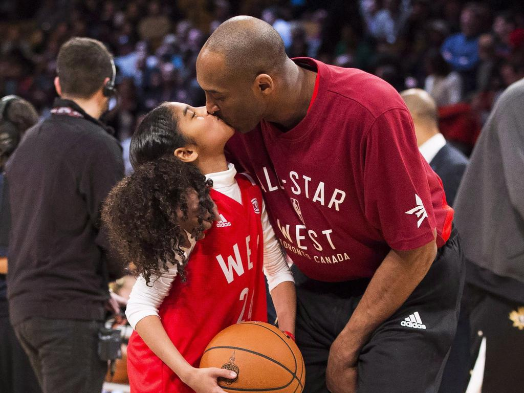 Kobe Bryant kisses his daughter Gianna. Picture: AP