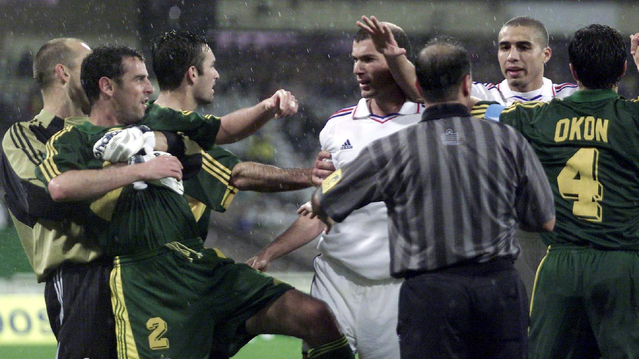 David Trezeguet (second from right) gets caught up in a scuffle with Australia's Kevin Muscat (second from left) and international teammate Zinedine Zidane during a friendly match between the Socceroos and France at the MCG in 2001.