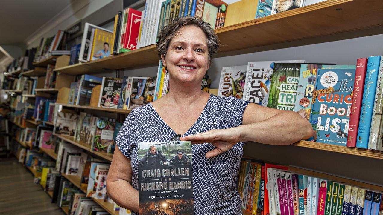 Boardwalk Books in Kingscliff will be hosting an author talk with Richard Harris - Katrina Rosetta holding his book. Photo: MEL BELANIC