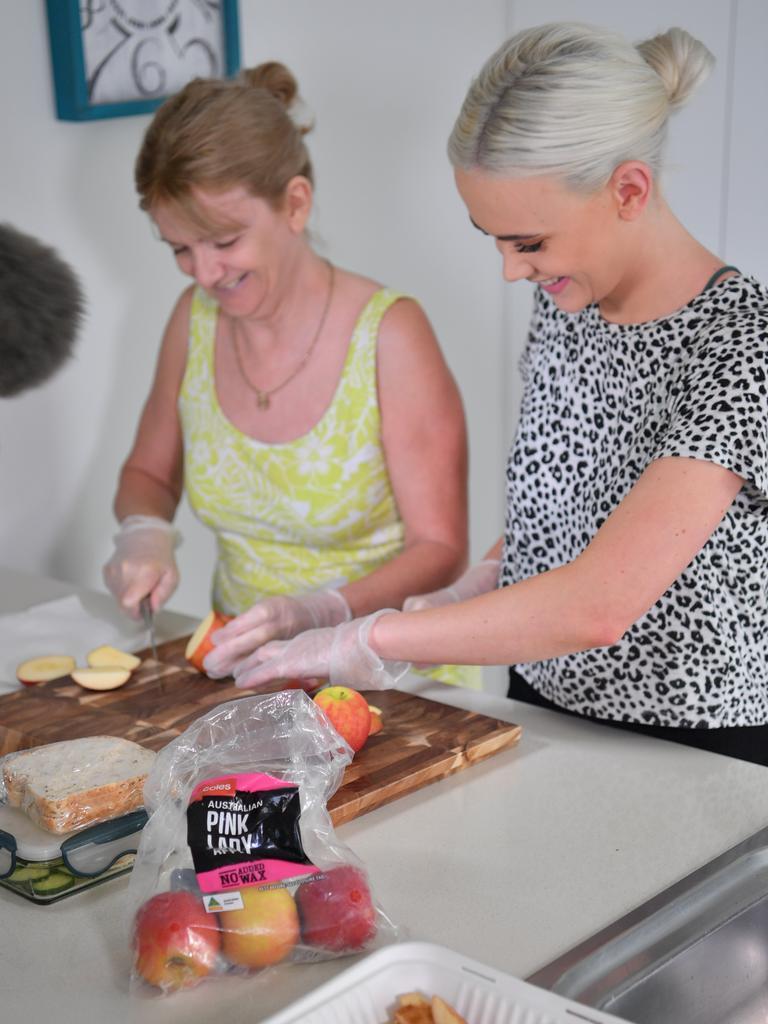 Stephanie Hughes and her mum Valerie Agnew preparing the meal. Photo: John McCutcheon