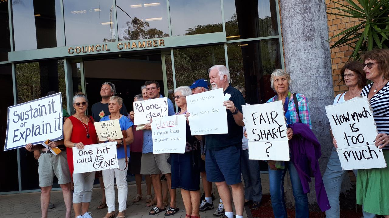 Woolgoolga resident opposed to the dam water sell-off placarded the council chambers ahead of the extraordinary Council meeting on January 13.