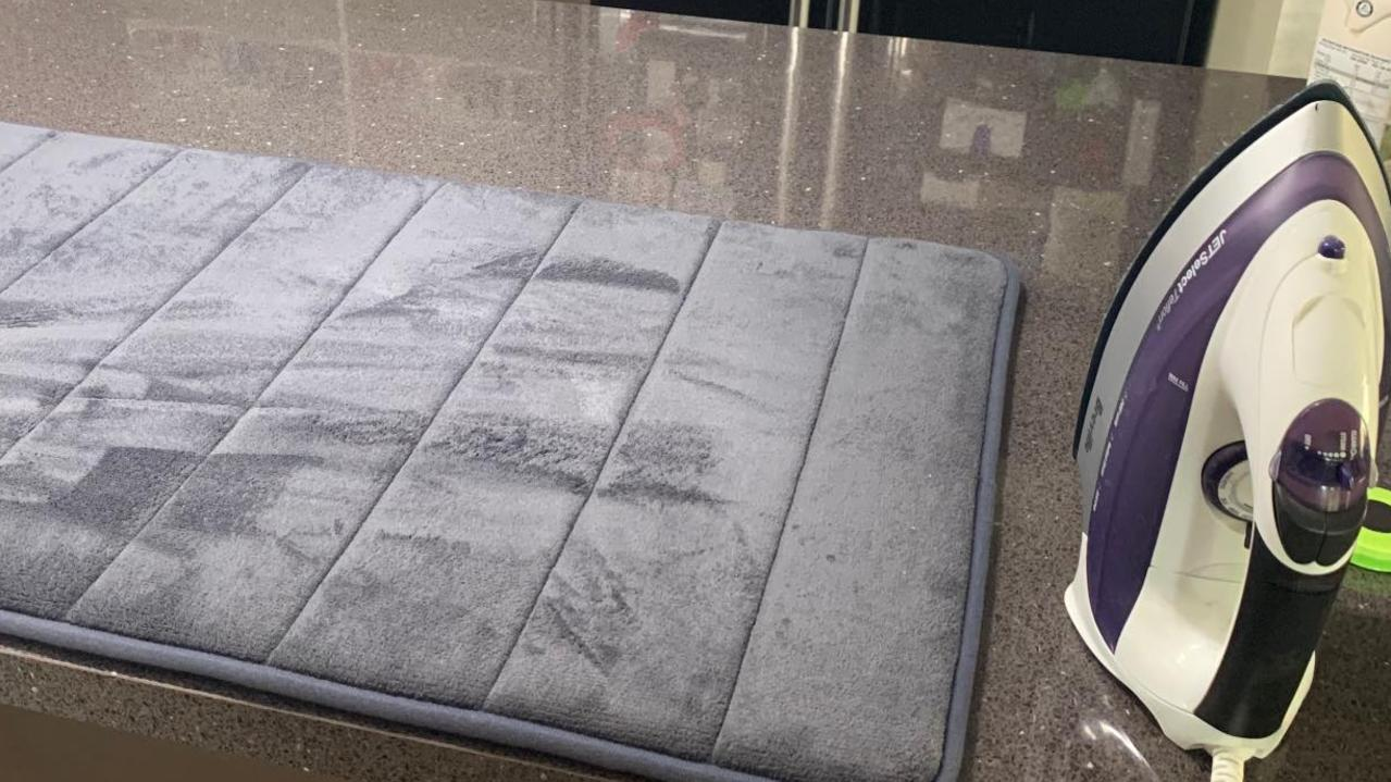 A Kmart shopper has revealed she uses the store's $12 memory foam bath mat when she can't be bothered pulling out her ironing board – and fellow shoppers love the idea. Picture: Facebook/ KmartHacks&Decor
