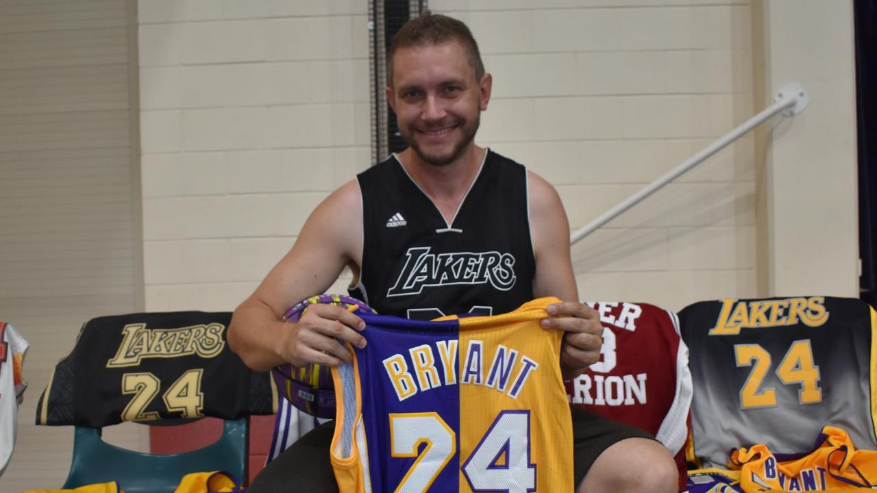 BIGGEST FAN: Gympie Basketballer Matt Smith with his LA Lakers Kobe Byrant jersey's. Photo: Bec Singh