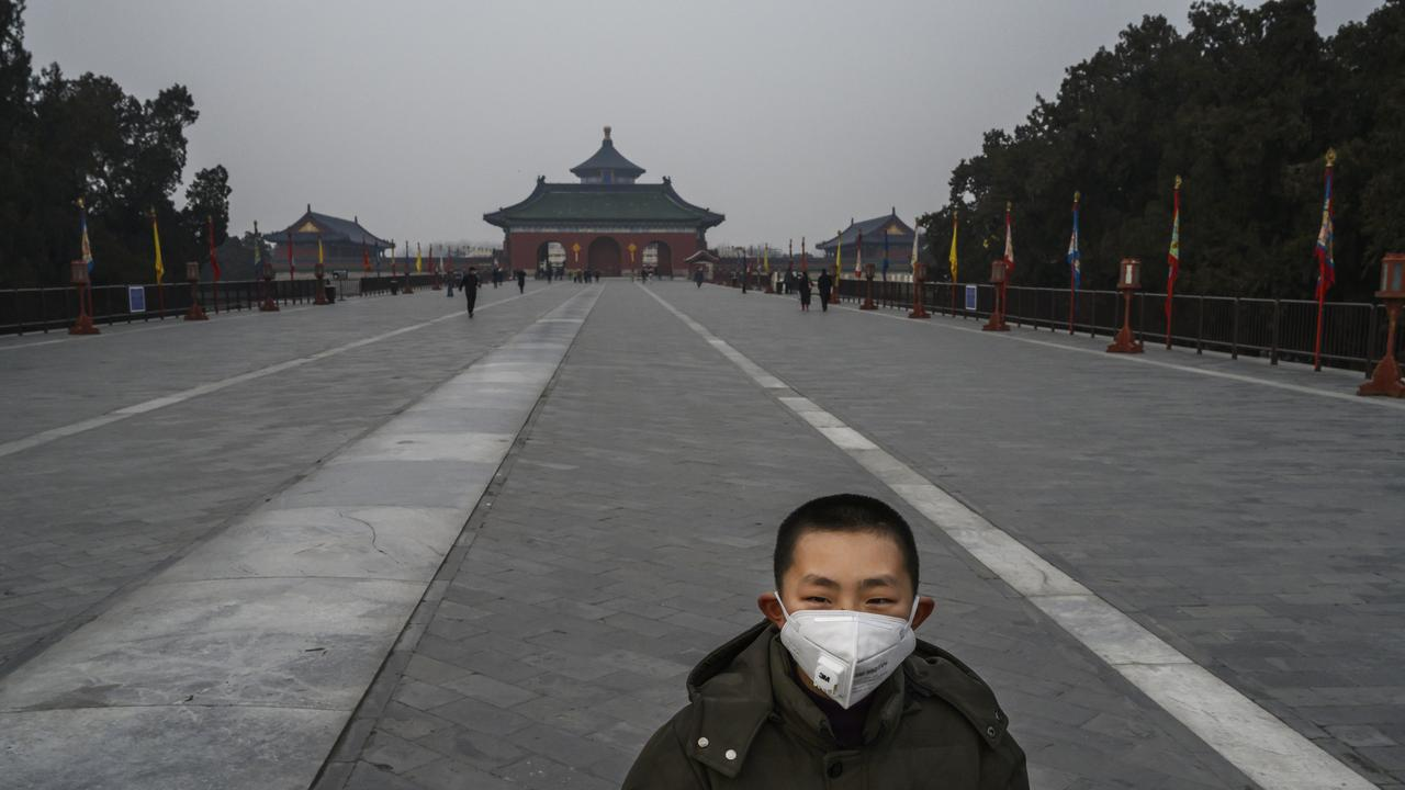 A Chinese visitor wear a protective mask as he tours the nearly empty grounds of the Temple of Heaven, which remained open during the Chinese New Year and Spring Festival holiday on January 27, 2020 in Beijing, China. Picture: Kevin Frayer/Getty Images