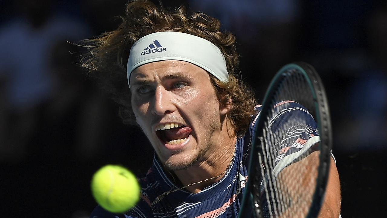 Alexander Zverev makes a backhand return to Switzerland's Stan Wawrinka. Picture: AP Photo/Andy Brownbill