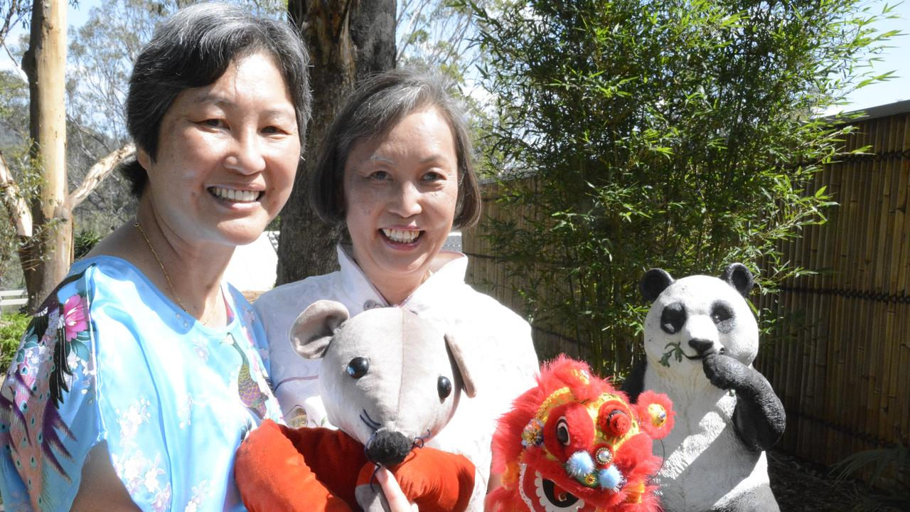 Preparing for Chinese New Year are (from left) Nancy and Daphne Fung.