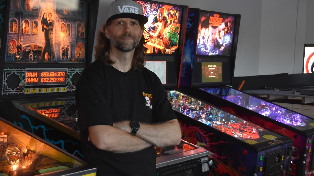 PINNIES: Arcade Box owner Andre Cooper with some of his prized pinball machines.