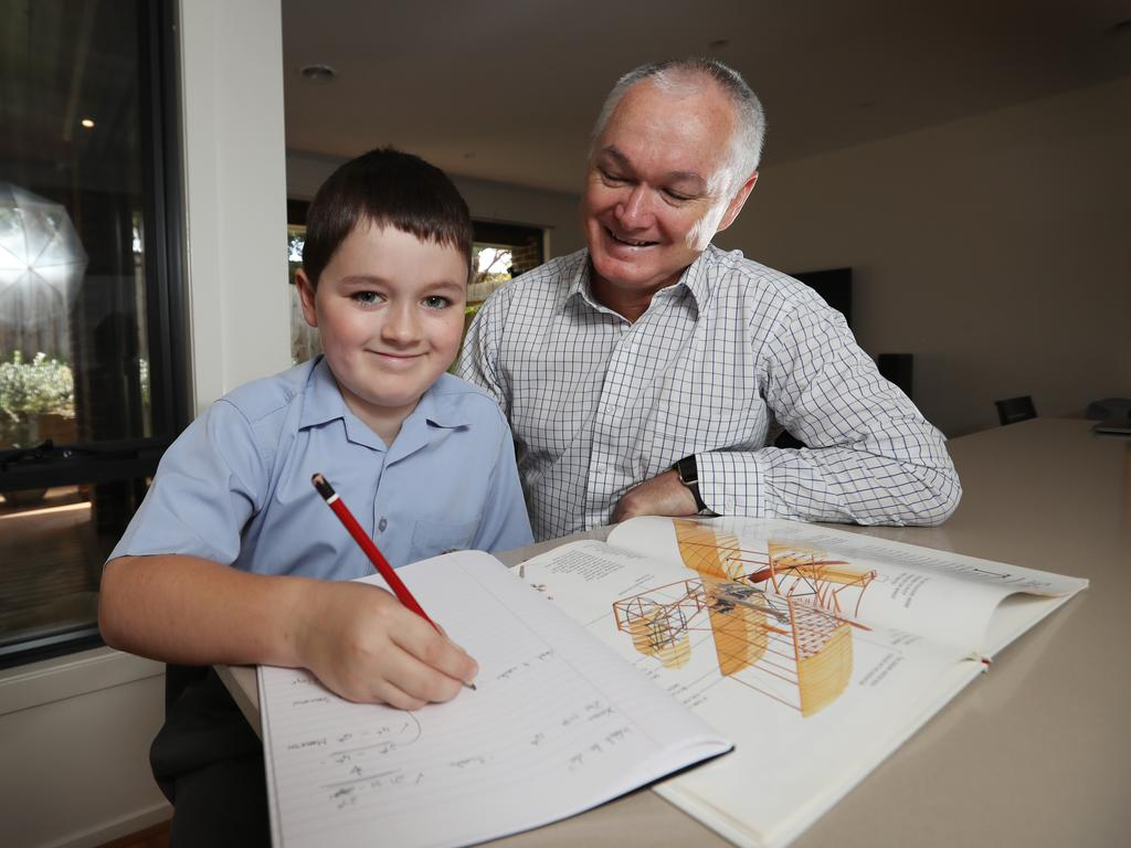 John Williams, with his son Liam, says private school fees are worth it. Picture: Alex Coppel.