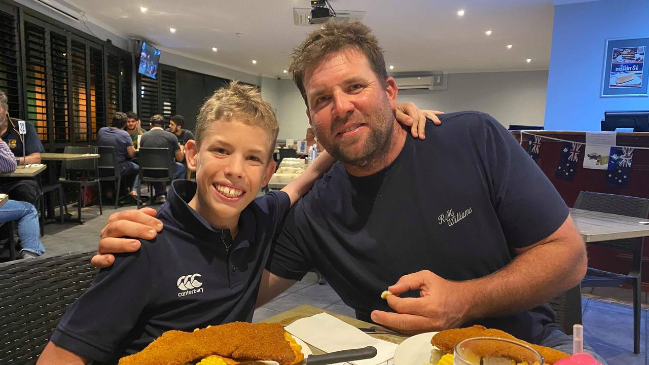 PROUD: Clermont's Oscar Finger with his dad Brendon.