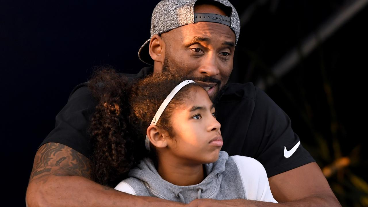 Kobe Bryant and daughter Gianna Bryant watch during day 2 of the Phillips 66 National Swimming Championships at the Woollett Aquatics Center on July 26, 2018 in Irvine, California. Picture: Harry How/Getty Images)