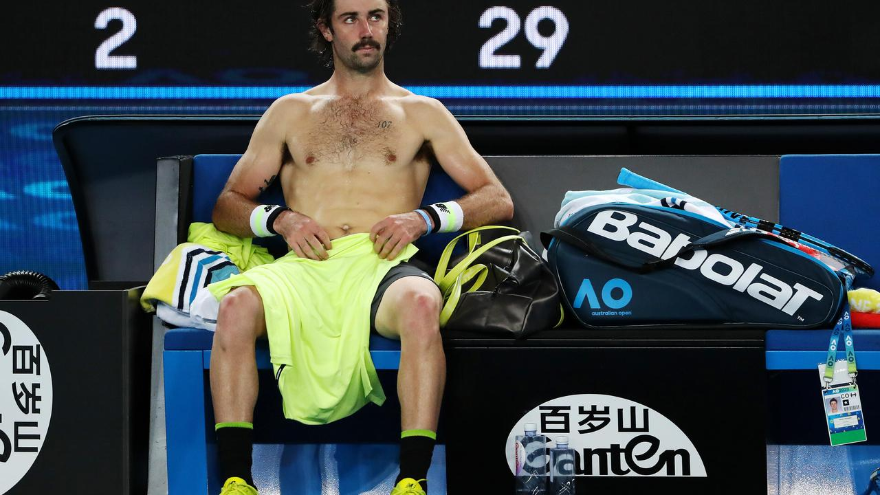 Australian tennis player Jordan Thompson surrounded by Ganten brands and Ganten water bottles Picture: Mark Stewart