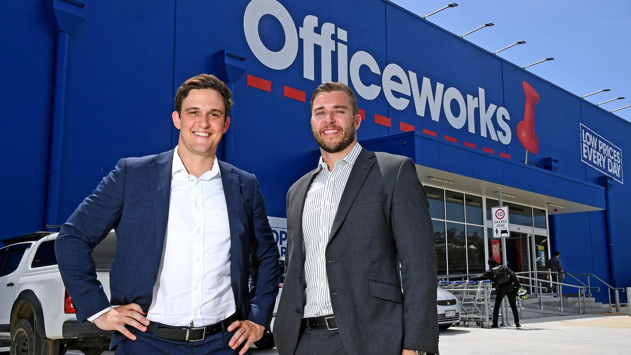 Elliott O'Shea and Tim Jones in front of Officeworks Windsor which they sold.