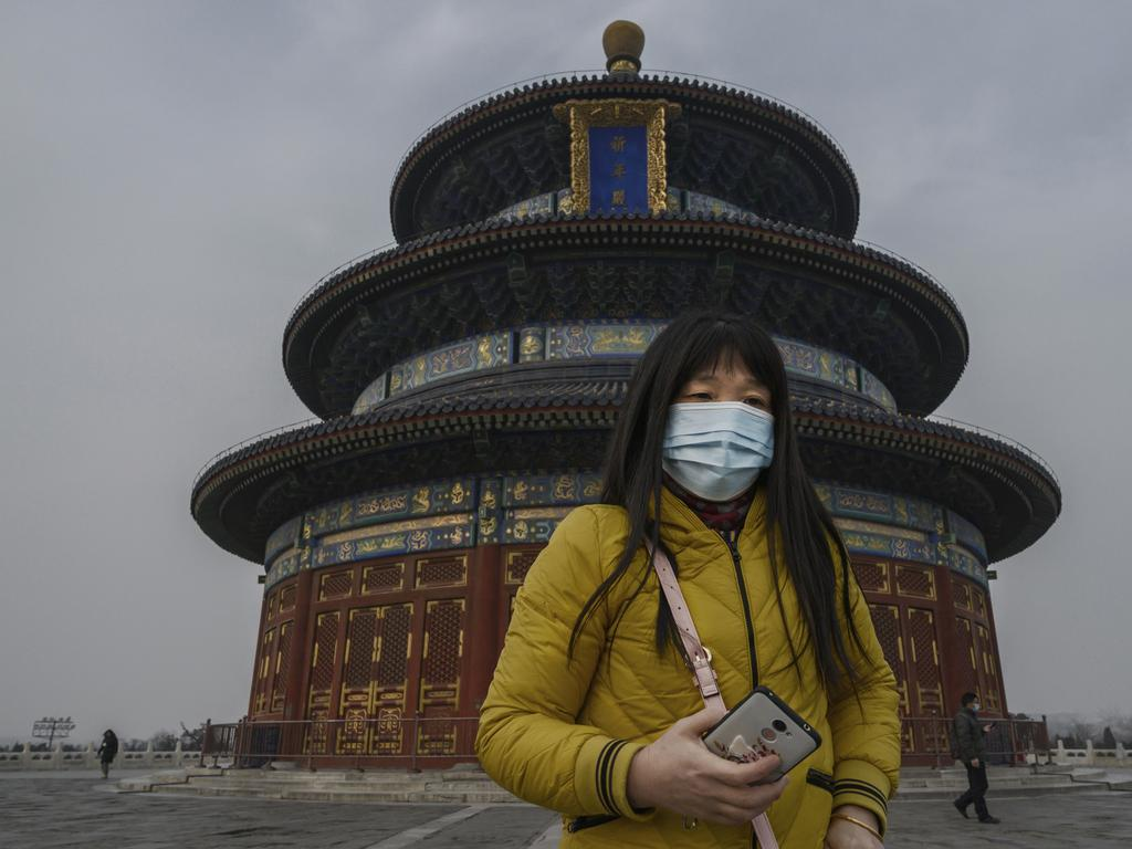 A woman wears a mask at the Temple fo Heaven. Picture: Kevin Frayer/Getty Images.