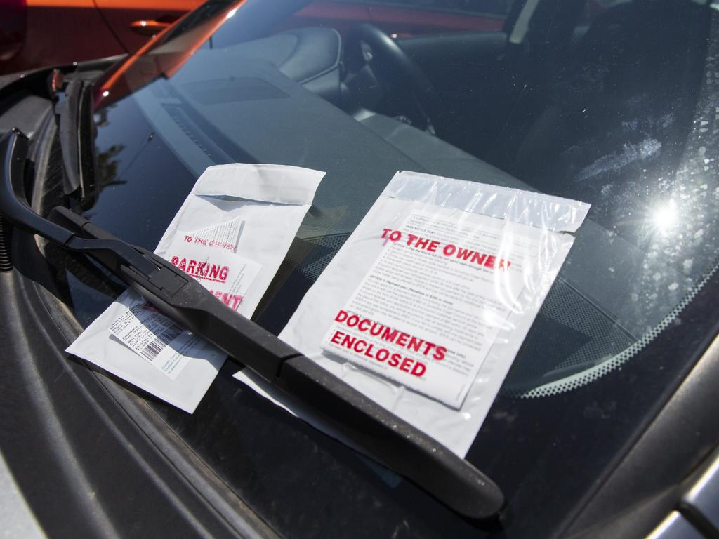 Parking tickets pile up on high profile solicitor Neil Lawler's Lexus outside Maroochydore courthouse on Thursday after he was charged with driving with a 0.270 blood alcohol reading. Photo Lachie Millard
