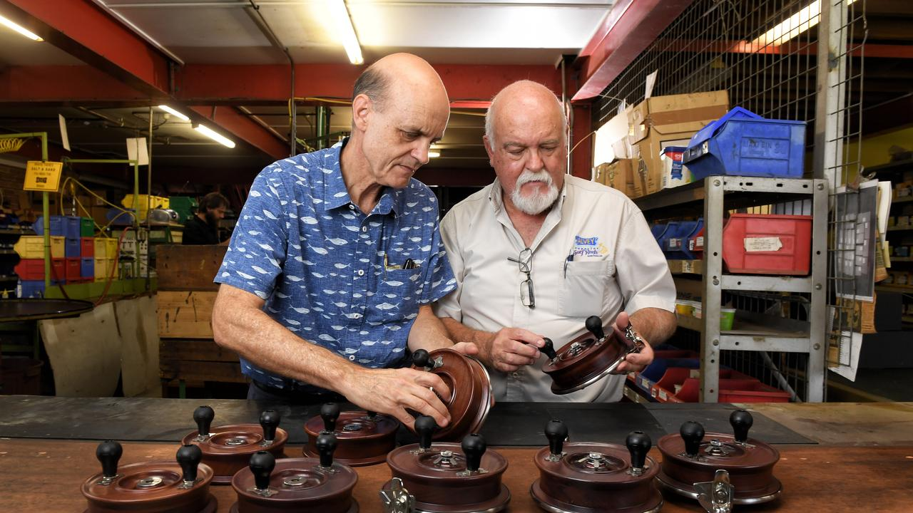 Glenn and Bruce Alvey inspect some of the commemorative reels.