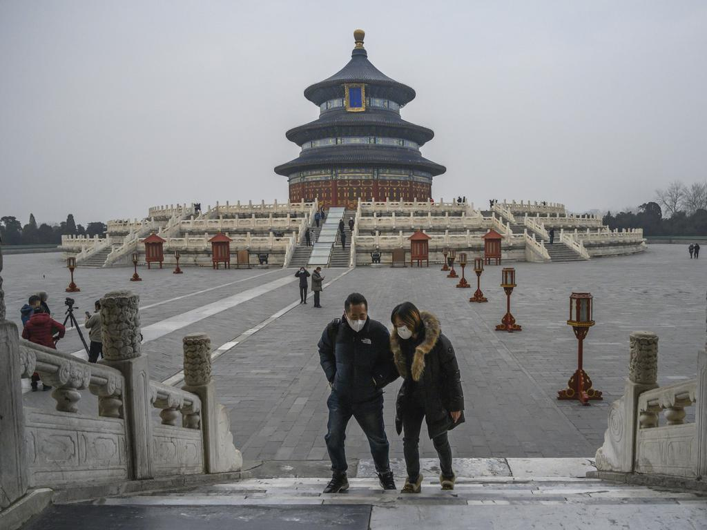 Visitors to the Temple of Heaven faced open spaces – a rare sight during the normally busy New Year. Picture: Kevin Frayer/Getty Images.