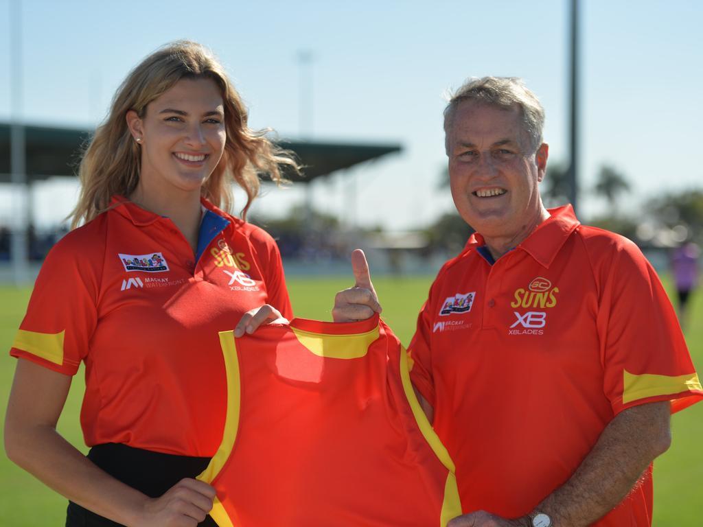 Gold Coast Suns player Lauren Bella with Mayor Greg Williamson at Harrup Park.